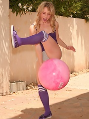 Playful Kara sits on her pink ball showing off her awesome little butt crack