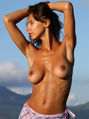 Busty brunette with scrumptiously tanned body.