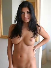 Jezebele shows off her shaved pussy