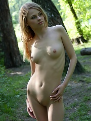 Zemani.com Anyutka - Naked beautiful young blond girl is walking in the wood.