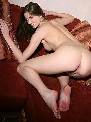 Skinny brunette Holly spreading on the sofa